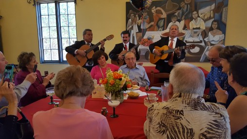 Mariachis serenade Papa Fred and family