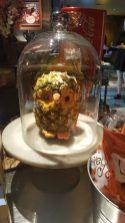 Creative pineapple owl under a cloche