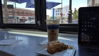 Iced caramel macchiato and chocolate chip scone