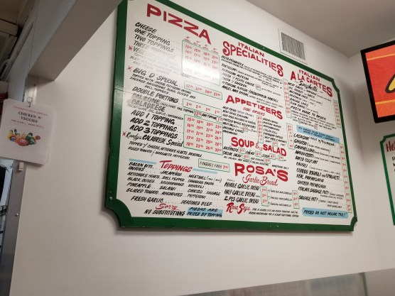 The main menu board at Domenico's take out