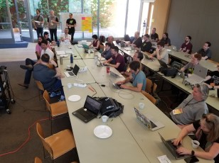 Early morning sessions for hack day are announced.
