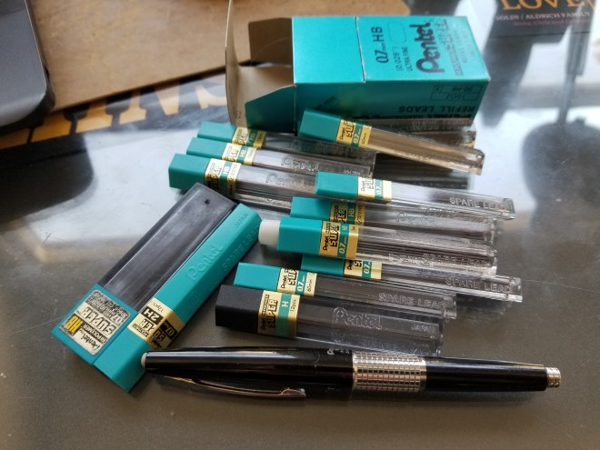 about a dozen tubes of refill lead and a lonely non-compatible black mechanical pencil
