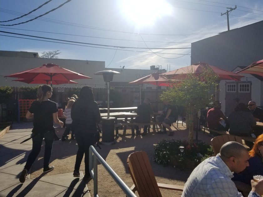 Long picnic tables and red umbrellas provided some great ambience with the sun shining brightly in the late afternoon