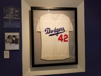 a framed Dodger&#039;s Jersey with a red <a href='https://boffosocko.com/tag/42/' rel='tag'>#42</a> on the front