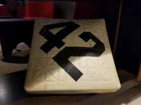 A baseball base emblazoned with a large 42