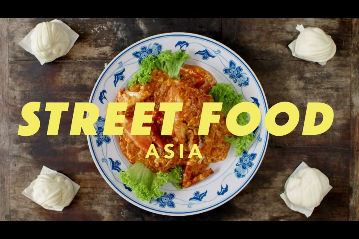 Plate of Asian food viewed from above with the title of the show overlain in yellow block letters