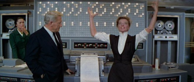Screencapture of Tracy and Hepburn in the movie The Desk Set.