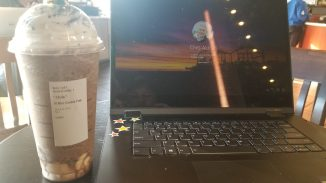 Venti iced drink next a laptop computer