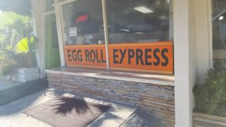 A big orange Egg Roll Express sign in the window keeps you from walking by