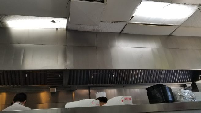Their cook area is quite smoky and needs a good scrub down. Robert Irvine would disapprove of the dust, grease, and lack of cleanliness here. Look at the grime on the ceiling.