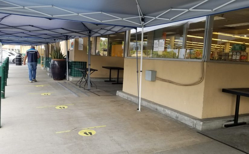 Social distancing markers and tents outside of Whole Foods for coronavirus