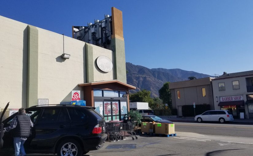 View of the market and the mountains in the background from the parking lot