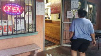 Entrance with coronavirus warnings at Burrito Express