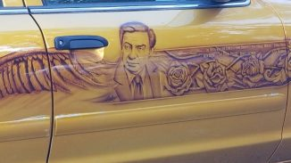 Close up of custom airbrushed photorealistic headshot of Jerry Orbach with roses and visual flourishes on the passenger side door.