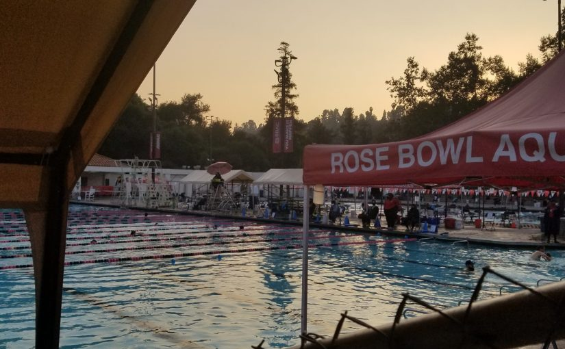 view of the pool in the waning light of the day