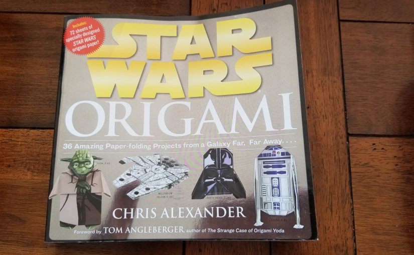 Star Wars Origami book sitting on wooden dining room table