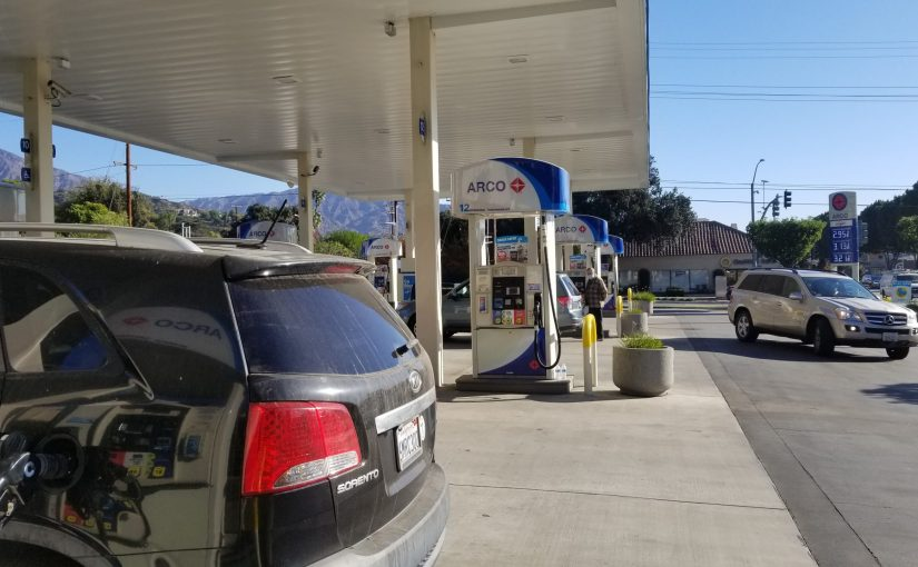 gas nozzel in car under Arco station awning