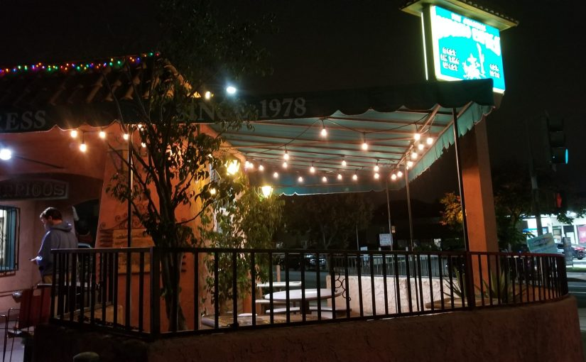 patio at Burrito express at night time with some bistro lights strung up under their awning
