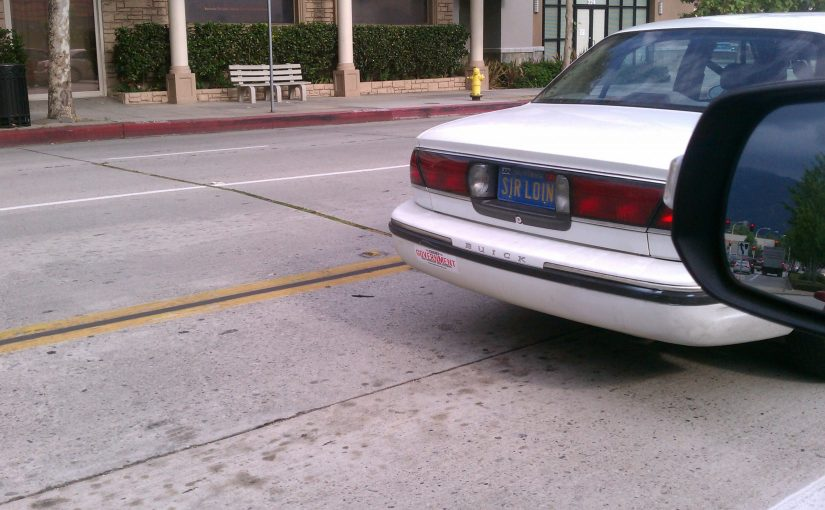 CA license plate SIR LOIN on a white buic