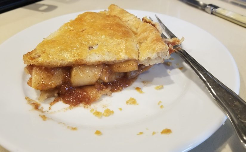 close up of apple pie on a plate