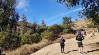 People beginning hike up the Backbone Trail in Will Rogers State Park
