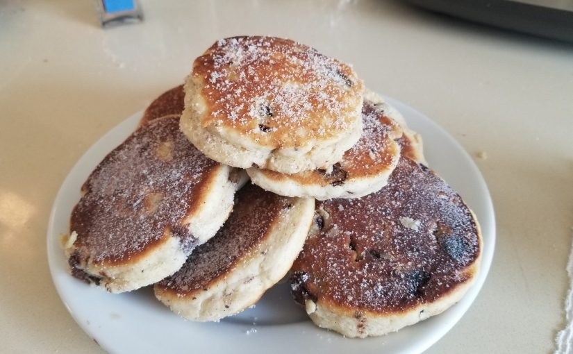 Plate piled high with Welsh cakes dusted with sugar