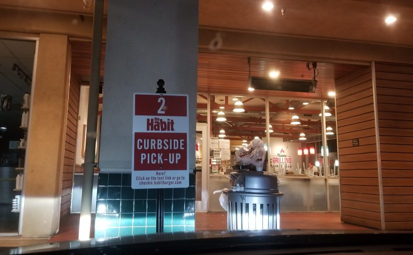 Curbside Pick up bay 2 in front of the Habit as viewed from inside car in the evening