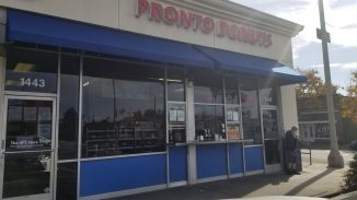 angle on Pronto Donuts storefront from parking right in front of the store