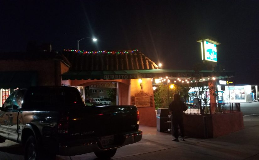 view of Burrito Express from across the street at night