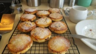 close up of sugared Welsh cakes on a cooling rack