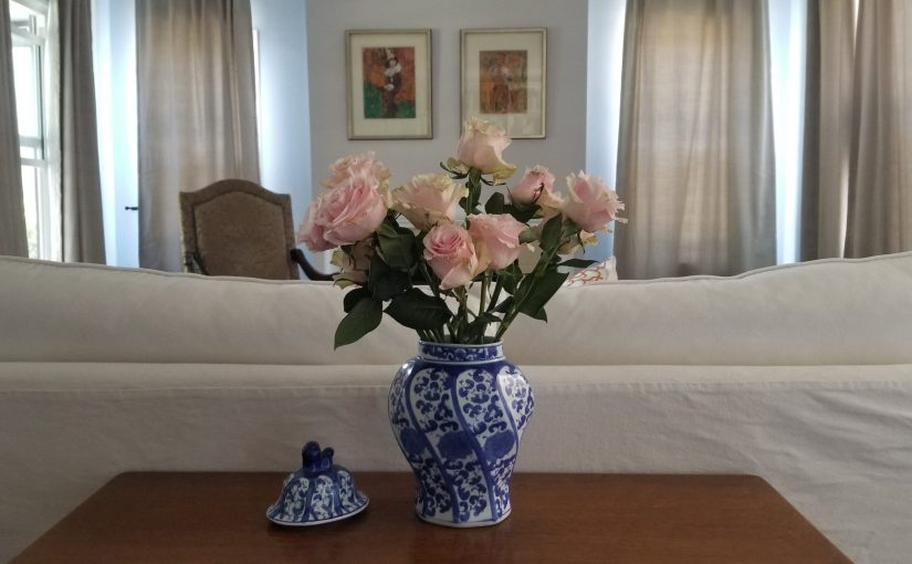 antique roses on a table in the living room