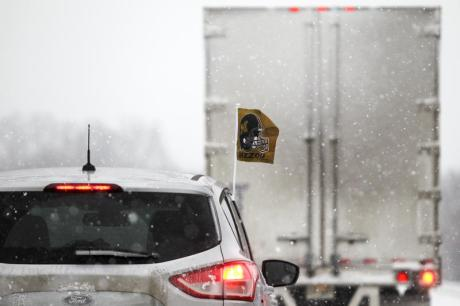 A Missouri traveler braves severe winter weather on I-57 in Illinois on Dec. 7. The interstate was riddled with will abandoned vehicles and stranded trucks. TIM TAI/THE MANEATER