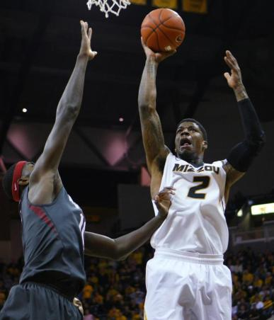 Senior forward Tony Criswell (#2) attempts a field goal during the first half of Missouri's game against Arkansas on Friday, Feb. 13 at Mizzou Arena in Columbia, MO. Missouri beat Arkansas 86-85 in the final minute of the game. MIKE KREBS/The Maneater