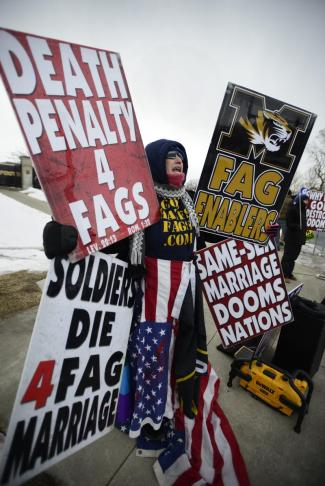 Shirley Phelps-Roper of the Westboro Baptist Church pickets in front of Mizzou Athletic Training Complex on Saturday. The church protested Michael Sam coming out. MICHAEL CALI /The Maneater