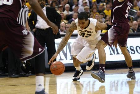 Junior guard Jabari Brown attempts to regain control of the ball during the second half of Missouri's game against Texas A&M on Wednesday, March. 5 at Mizzou Arena, in Missouri won in the final moments of the game 57-56. MIKE KREBS/The Maneater