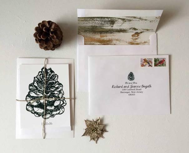 rustic-winter-pine-cone-invite-envelope