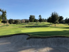 Side view of 10th green that also shows the nearby 13th green.