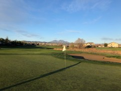Behind 6th green with another mountain view.