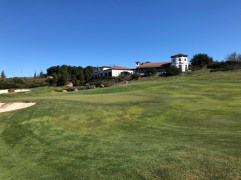 4th green with clubhouse above.