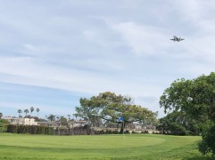 Another view of the 13th green with an F-18 making its approach for landing.