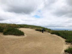Playing partner in the massive fairway bunker to show its scale.