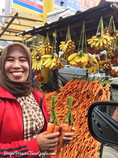 A carrots & bananas seller on the road before reaching Taman Safari.