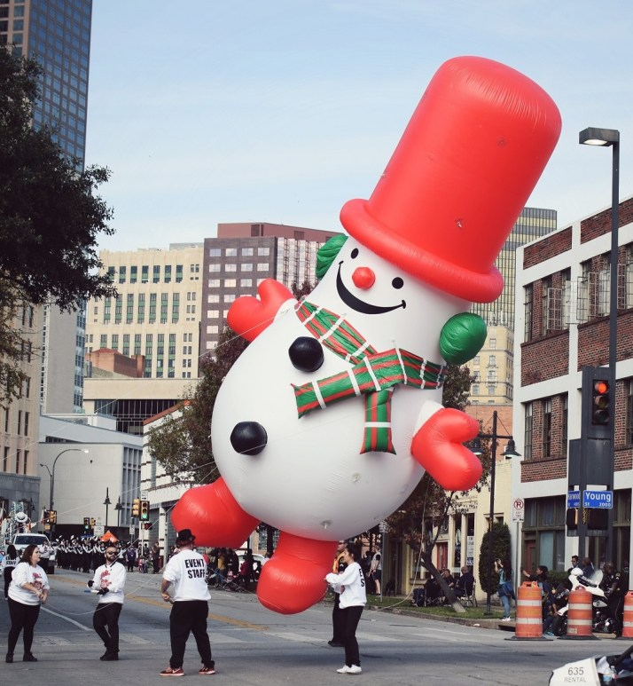dallas holiday parade downtown flying snowman inflatable