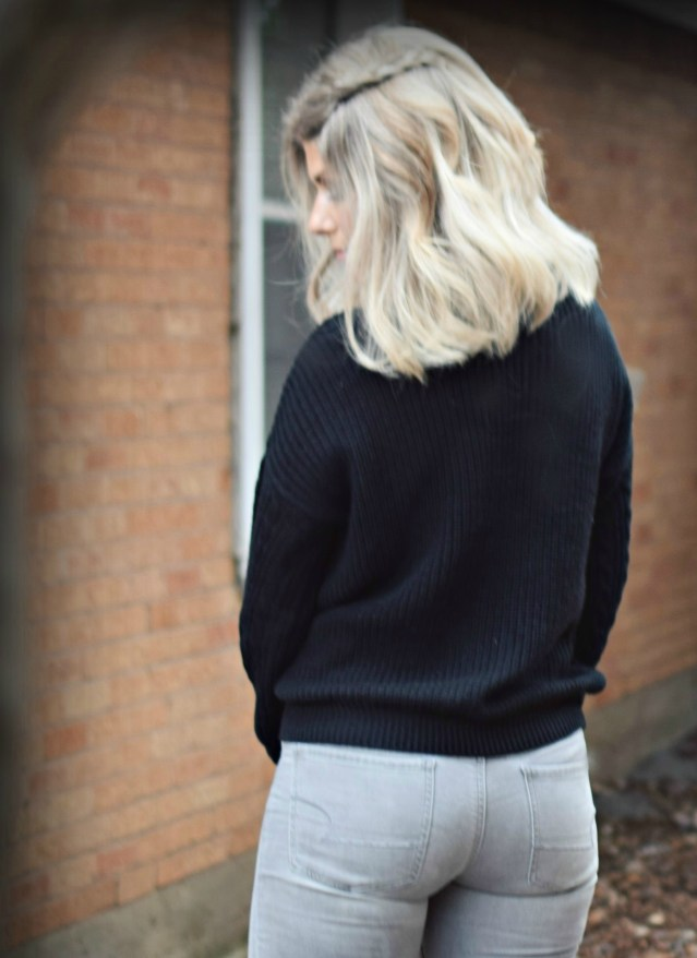 gray jeans and black sweater and new blonde lob haircut