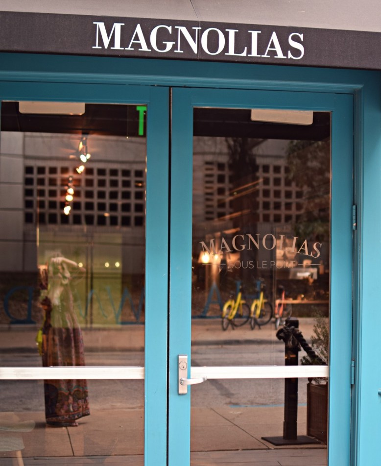 reflection at magnolias coffee dallas on harwood