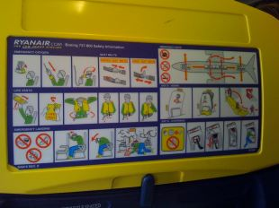 Front vs. back of the plane depending if you need to board first for priority storage in overhead bins (rear/furthest from the main door usually boards first) or if you need to be at the front/near the main door to be first to exit to catch a connecting flight. I usually only have carry-on baggage or at least keep 1-day of supplies in my onboard bag because of the frequency of lost luggage & to allow for changes in flight schedules.
