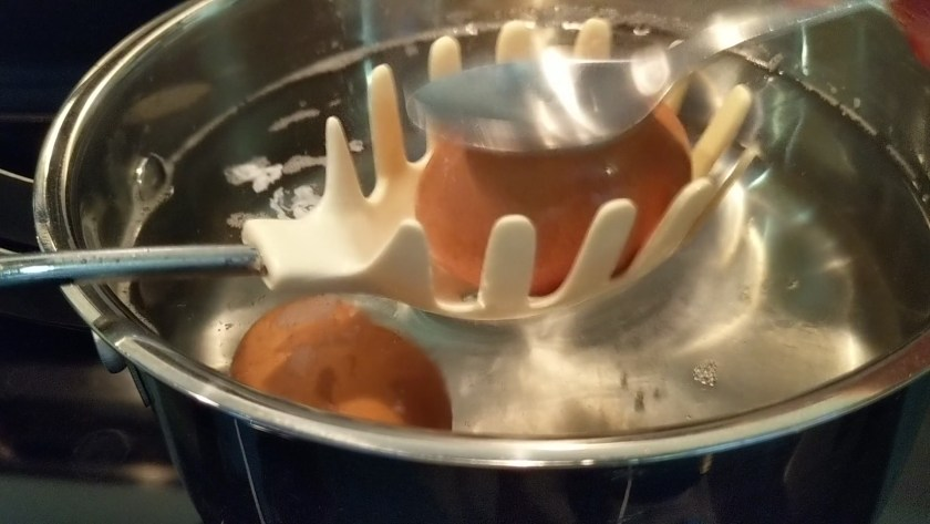 Immediately the time is up, drain the eggs, tap very gently with the back of a spoon to crack shells in several places, and run cold water into the pan, or transfer eggs to a sink of cold water