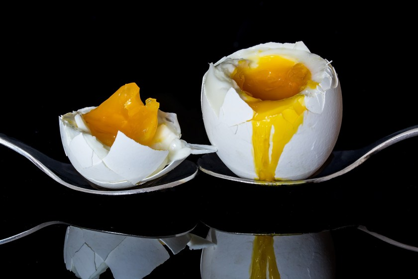 For halved eggs, lop the end off cleanly, as though you meant them to be that way