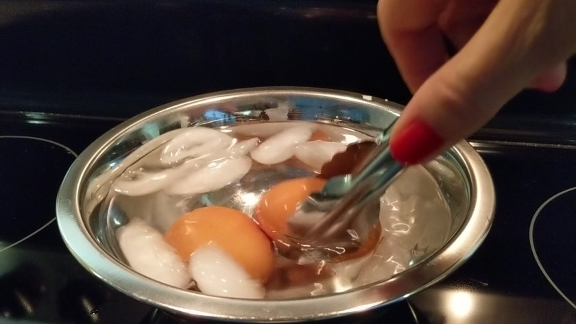 After 10 minutes, remove the eggs and slide them carefully into ice water to cool