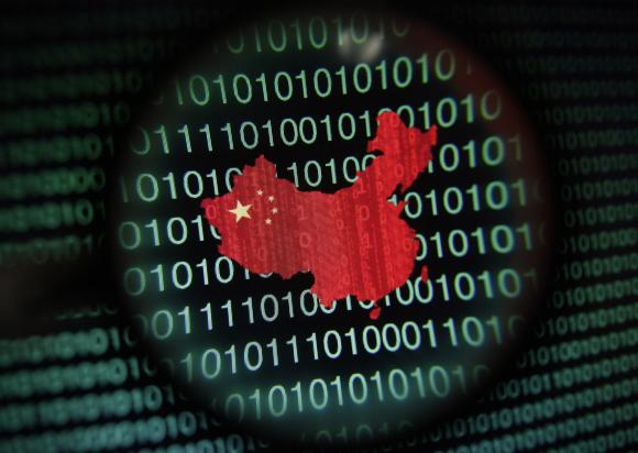A map of China is seen through a magnifying glass on a computer screen showing binary digits in Singapore in this January 2, 2014 photo illustration. Picture taken January 2, 2014. REUTERS/Edgar Su.